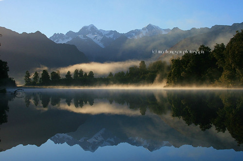 light newzealand mist lake mountains reflection nature water weather rural sunrise landscape mood nz foxglacier mtcook southisland westcoast southernalps westland lakematheson nationalgeographic waterscape mttasman southwestland rinathompson