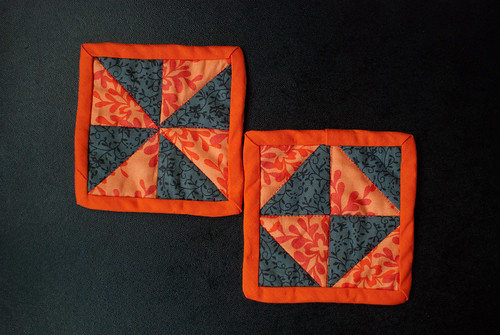 Two orange & grey coasters