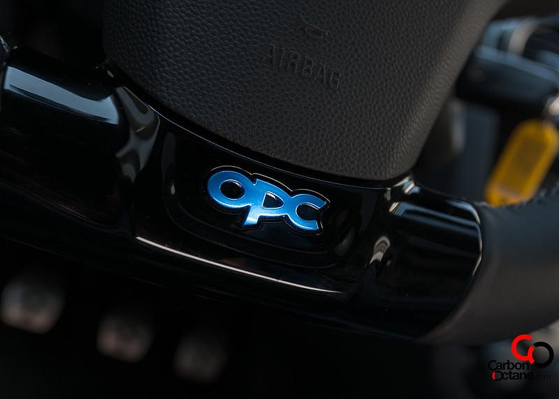 2014_Opel_Corsa_OPC_Nurburgring_Edition_logo_steering_wheel