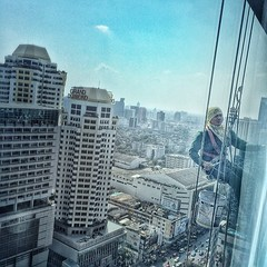 If you think your life is hard, my brother here is sitting on a bench cleaning a window on 26th floor suspended on a rope. Talk about true hustlin' #respect #perspective #humble #bangkok #thailand
