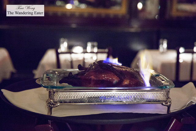 Roast duck in flames simmering down