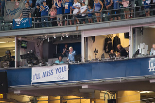 Vin Scully waving.