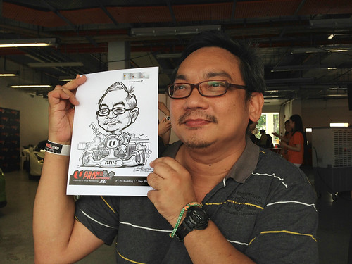 caricature live sketching for NTUC U Grand Prix Experience 2013 - 1