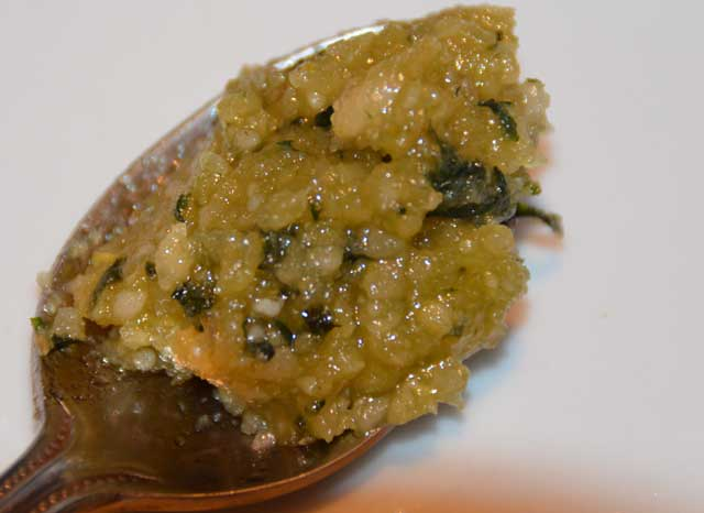 Basil leaves, pinenuts and parmesan in olive oil pressed into a paste