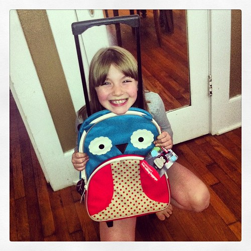 Pretty merry about her new rolling carry-on that just got delivered.   #preparingforafrica #futurewgirl #odyowl #muwbound #missionarykid #owlstuff #skiphopzoo