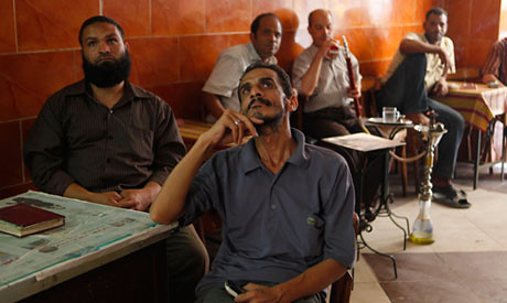Egyptian unemployed men in coffee shop. The economy is not improving in the North African state. by Pan-African News Wire File Photos