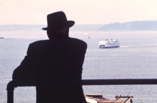 Man watching ferry from Pike Place Market, 1972
