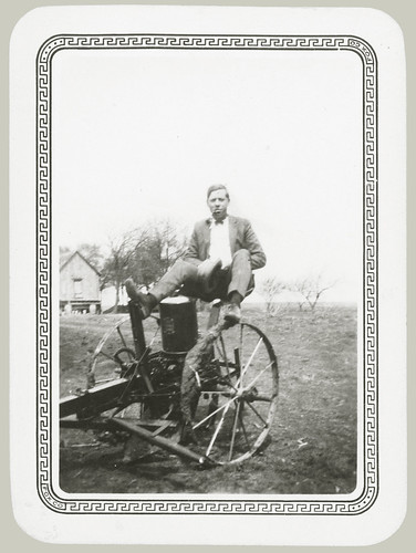 Man sitting on farm equipment