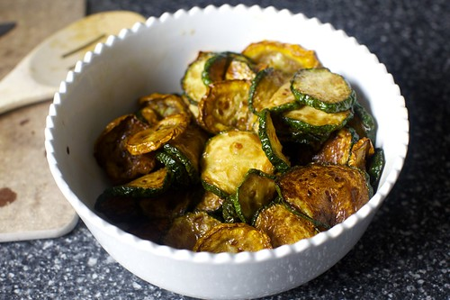 dousing fried zucchini with red wine vinegar