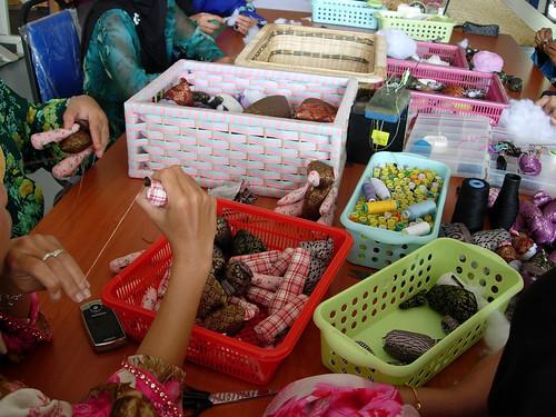 Women making songket teddy bears