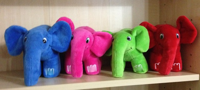 The red elephpant joins the others on the shelf