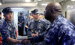 Adm. Harry Harris greets Sailors aboard the guided-missile destroyer USS Spruance (DDG 111) in Singapore, Jan. 22. (U.S. Navy photo by Cryptologic Technician Technical 2nd Class Shawn D. Stone)