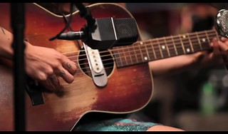 Segarra's hands on her guitar