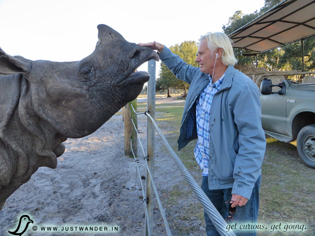 PIC: Bill of JustWander.in petting an Indian Rhino