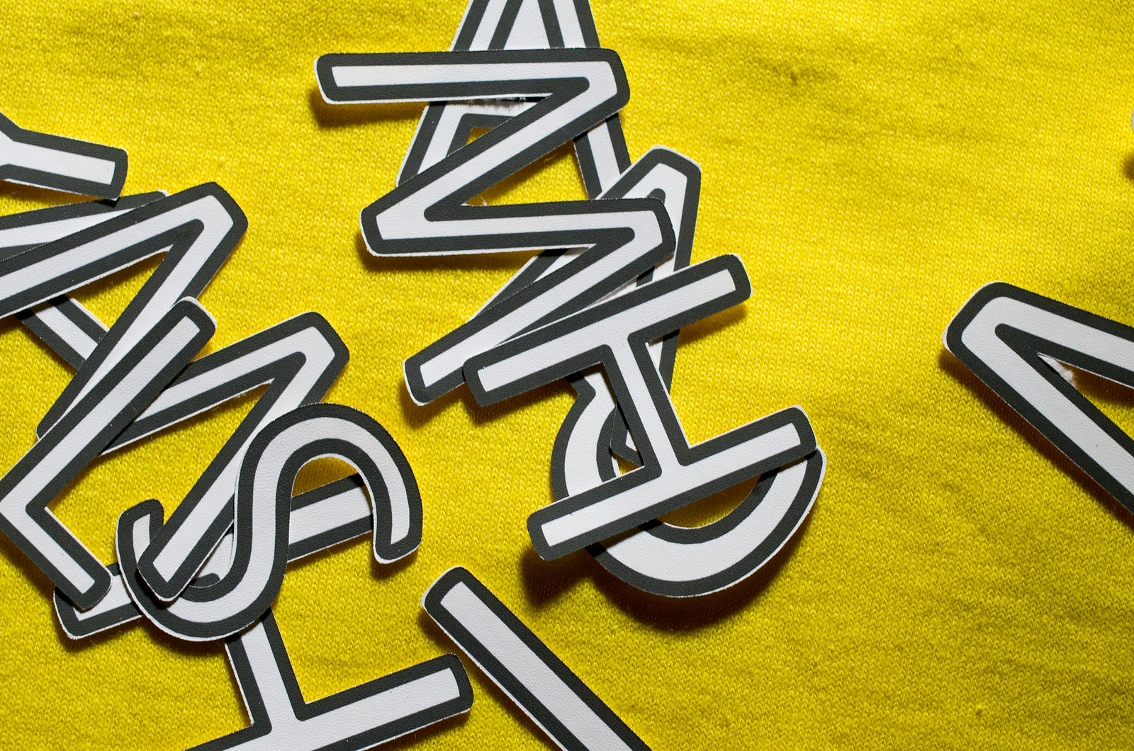 picture of jumbled letters on a yellow fabric