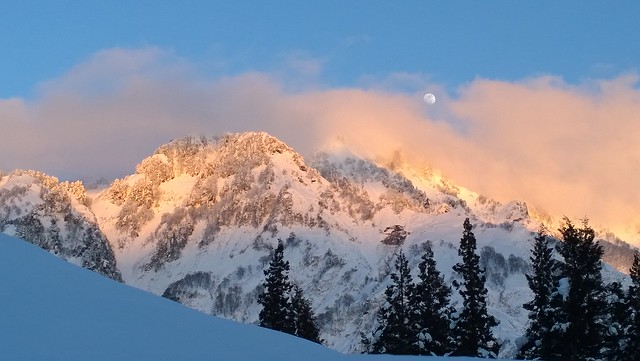 White moon over the winter mountains