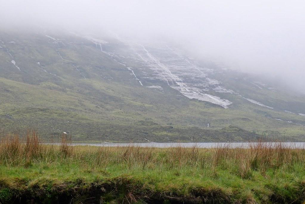Rainwater on the slabs below Sgurr Ban