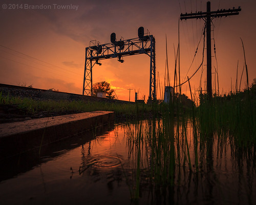 railroad light sunset ohio sun reflection rain clouds railway trains co signal csx railroadsignal powellohio signalbridge brandontownley