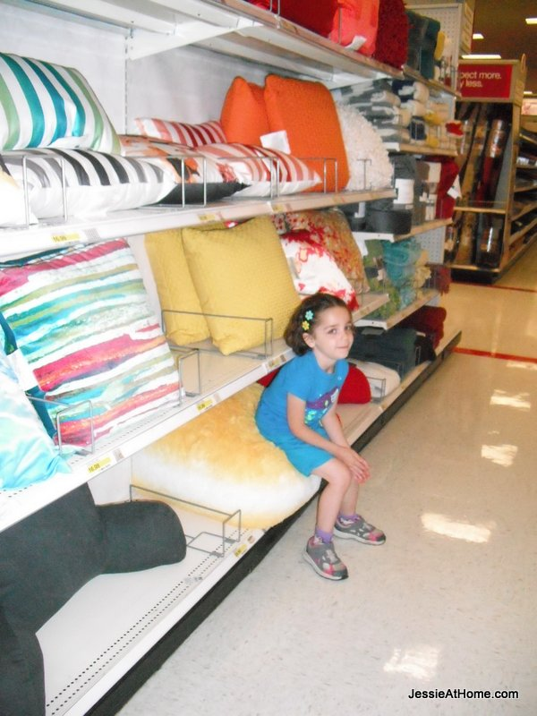 Vada-on-a-yellow-bean-chair-at-Target