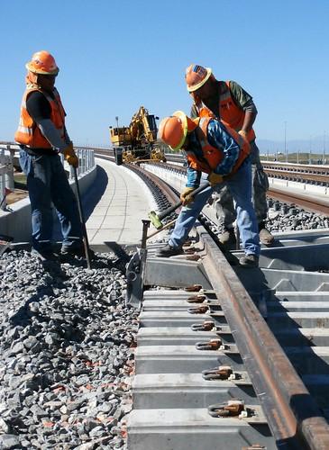 Photo of track installation on Peña Bridge on East Rail Line