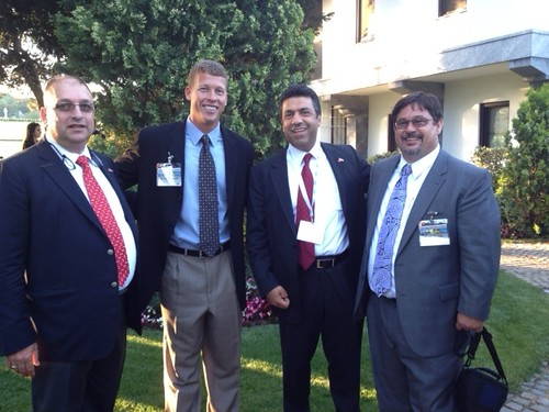 Scott Hudson (second from left) stands in front of the U.S. Embassy in Turkey with two Turkish businessmen, a nut buyer (left) and marketing group CEO.  The fourth man is a soybean farmer from the Midwest (far right).