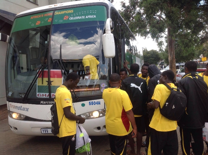 Players board their official bus after victory