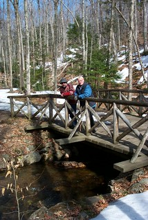 Mom and Dad standing on a bridge