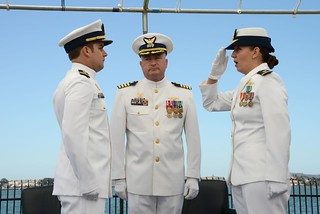 Lt. j.g. Katie Spira assumes command of U.S. Coast Guard Cutter Haddock from Lt. Anthony Myers during a change-of-command ceremony held at Coast Guard Sector San Diego July 11, 2014.  The Haddock is an 87-foot patrol boat based in San Diego. (U.S. Coast Guard photo by Petty Officer 1st Class Henry G. Dunphy)