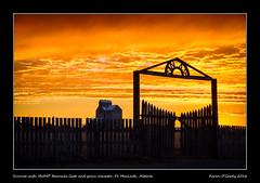 Sunrise with NWMP Barracks Gate and grain elevator, Ft. MacLeod, Alberta