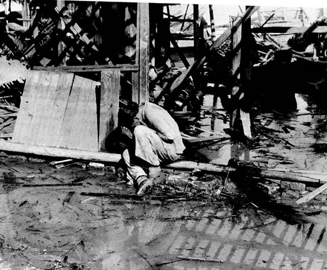 #A Chinese woman weeps in the rubble following a Japanese air raid in Hankou. Hankou was captured by the Japanese invaders in 1938 after the Battle of Wuhan. Hankou, Wuhan, Hubei, Republic of China. September 1938. Image taken by Robert Capa. [1162 x 960]