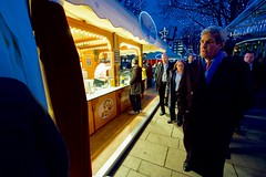 U.S. Secretary of State John Kerry walks through the Weisser Zauber 'White Magic' Christmas market on December 7, 2016, as he visits Hamburg, Germany, to attend a meeting of the Organization for Security and Co-operation in Europe. [State Department photo/ Public Domain]