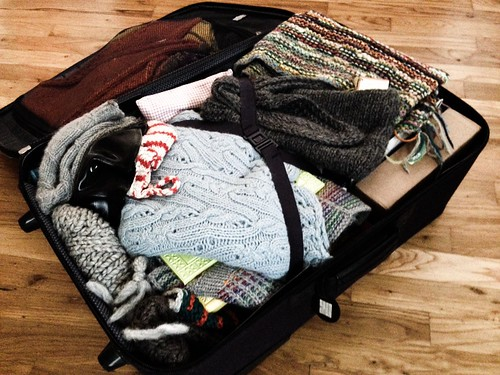 giant suitcase full of handknits