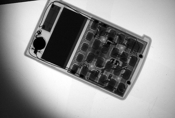 A hand-held calculator that was X-rayed by Los Alamos National Laboratory researchers using the MiniMAX camera, a lightweight, portable X-ray machine that could revolution imaging of closed containers.