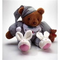 Teddy bear in nightgown and slippers