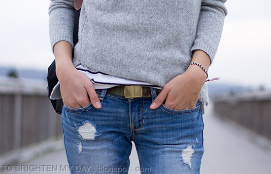 gray cowlneck sweater, striped top, camo belt, ripped jeans