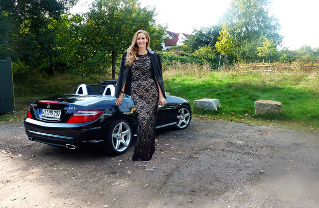 Tall woman with mercedes cabrio