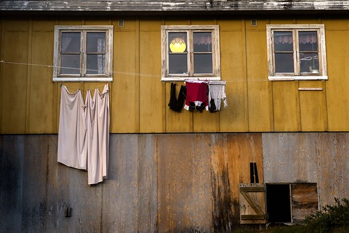Laundry drying on Yellow Wall