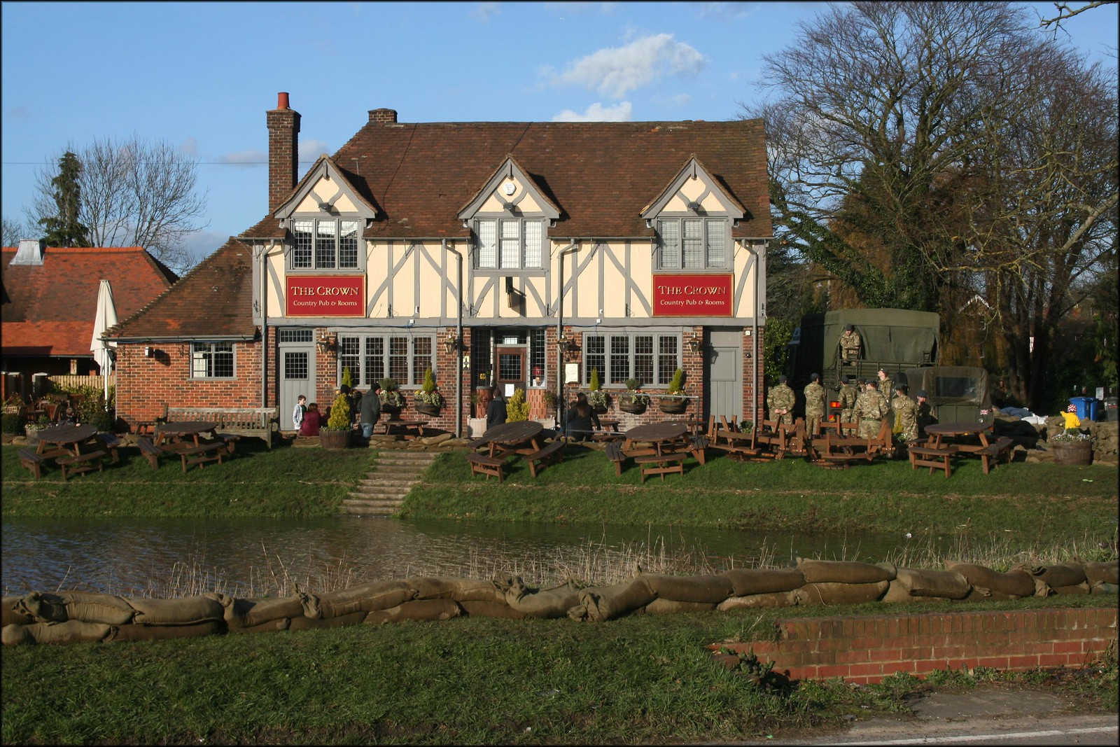 Cookham The army have taken over this pub to distrbute sandbags to help with the Thames which has flooded parts of the village.