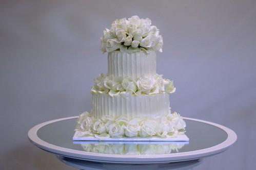 Wedding Cake 2 tier w/ Swiss butter cream and 90 fresh white/cream roses