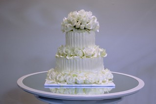 Wedding Cake 2 tier w/ Swiss butter cream and 90 fresh white/cream roses | by Rexness