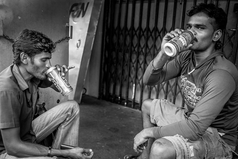 Drinking after lunch - alcohol may have fueled the riot of 8th Dec, but most migrant workers are friendly and harmless, and just want to make a living for their family.