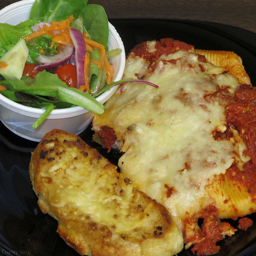 Stuffed shells, cheesy garlic bread, and salad with an excellent zinfandel vinaigrette by Coyoty