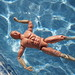 Small photo of Action man swimming