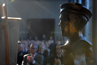 A bust of Douglas A. Munro – created by John Tuomisto-Bell and sculpted and molded by Tyson Snow – was unveiled at the dedication ceremony of the Douglas A. Munro Coast Guard Headquarters Building in a ceremony held  November 113, 2013 U.S. Coast Guard photo by Petty Officer 2nd Class Patrick Kelley