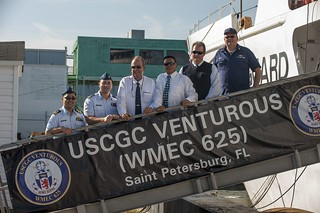 Coast Guard crew members from Sector St. Petersburg, Fla., and delegates from the Kingdom of the Netherlands Island of Aruba during an International Port Security Program reciprocal engagement tour at the sector Wednesday, Dec. 11, 2013.? Lt. Cmdr. David Otani, (left) the liaison officer for the the tour, accompanied the delegation to the sector where they met with sector staff, toured Coast Guard Cutter Venturous, a 210-foot medium endurance cutter, and visited a cruise ship terminal. (U.S. Coast Guard photo by Petty Officer 2nd Class Michael De Nyse)