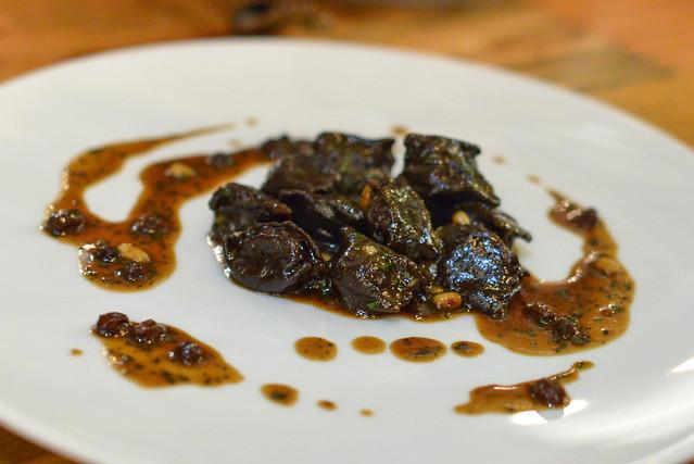 Agnolotti alla Vaccinara. cacao pasta parcel. braised oxtail. burro fuso. grana padano. pine nut. currants.