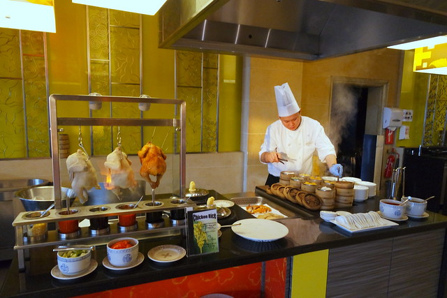 The Chinese cuisine counter as the chef on hand fusses over his delicious charges