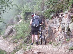 The start of the TMB and Helen pushing her bike along the Petit Balcon Sud Image