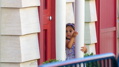 Girl at Minion Doors
