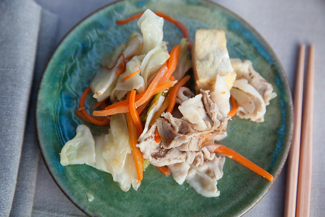 Stir fried cabbage and carrots with sliced pork belly